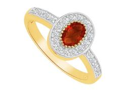 Garnet and Cubic Zirconia Ring in 14K Yellow Gold
