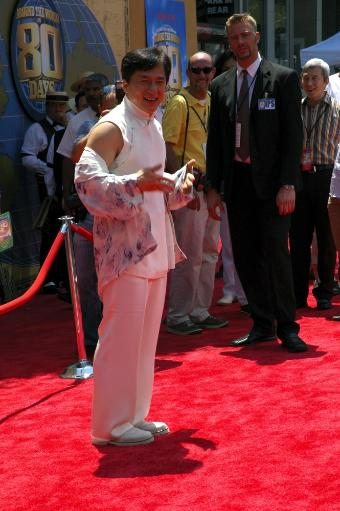 Actor Jackie Chan Smiles To The Cameras At The Premiere Of Around The World In 80 Days, On June 13,2004 At The El Capitan Theatre, In Hollywood.