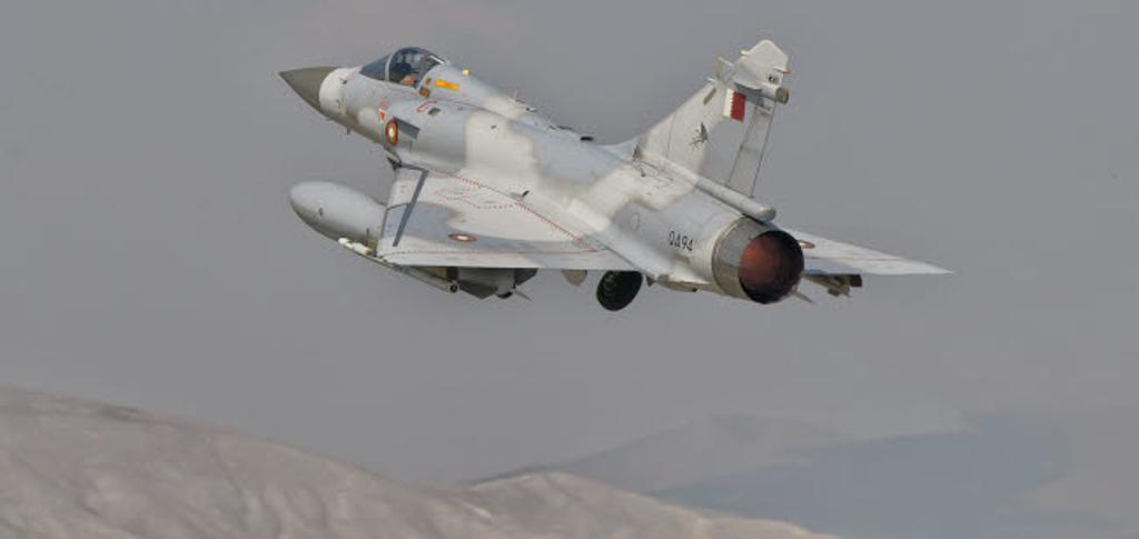 A Qatar Emiri Air Force Mirage 2000 taking off Poster Print by Giovanni Colla/Stocktrek Images