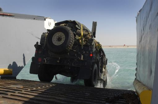 Arabian Gulf, November 13, 2011 - A Humvee drives down the ramp of a landing craft utility aboard the amphibious dock landing ship USS Whidbey.