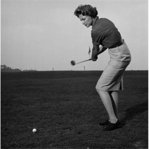 Posterazzi SAL2558894 Mid Adult Woman Swinging a Golf Club on a Golf Course Poster Print - 18 x 24 in.