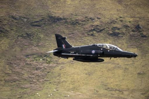 A Hawk T2 jet trainer aircraft of the Royal Air Force low flying over North Wales Poster Print