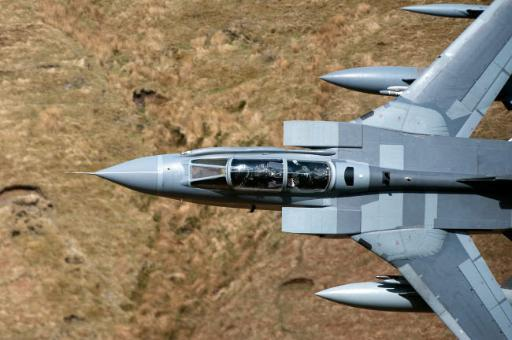 A Royal Air Force Tornado GR4 during low fly training in North Wales Poster Print by Andrew Chittock/Stocktrek Images