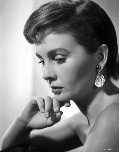 Jean Simmons Close Up Portrait in Shoulder Dress and Coin Earrings with Chin Leaning on the Right Hand Photo Print