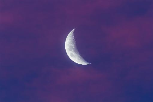 April 5, 2014 - The waxing moon as seen from Australia and seen in the evening twilight sky among pink sunset clouds. Poster Print