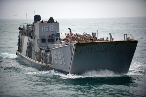 Arabian Gulf, January 31, 2011 - A Landing Craft Utility 1681 approaches the well deck of the amphibious transport dock ship USS New Orleans.