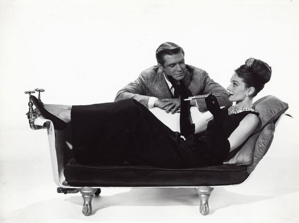 A publicity still of Audrey Hepburn and George Peppard in Breakfast At Tiffanys Photo Print