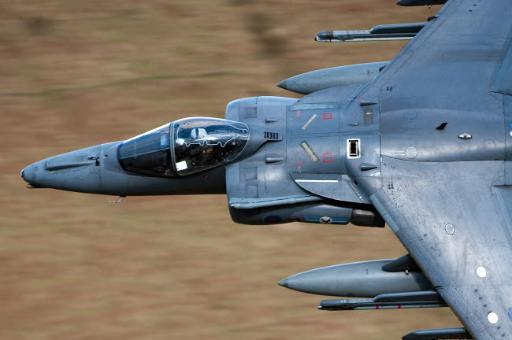 A Royal Air Force Harrier GR9 flying low over North Wales Poster Print by Andrew Chittock/Stocktrek Images