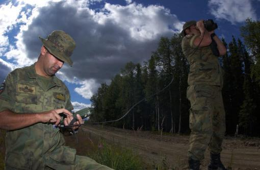 Airmen use a range finder and GPS unit to mark a target location Poster Print by Stocktrek Images