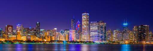 Chicago skyline with Cubs World Series lights night, Lake Michigan, Chicago, Cook County, Illinois, USA Poster Print by Panoramic Images (36 x 12)