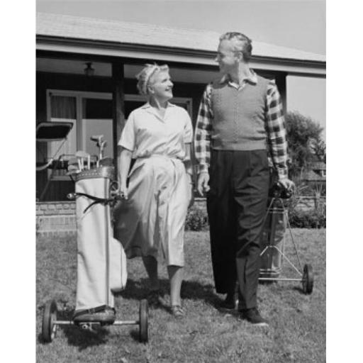 Posterazzi SAL25548892 Senior Couple Walking with Golf Clubs on Golf Course Poster Print - 18 x 24 in.