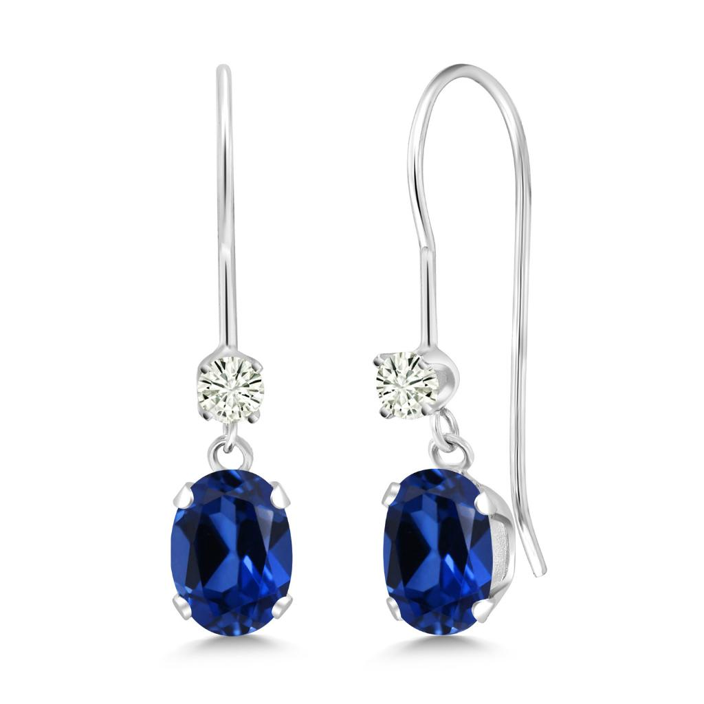 14K White Gold Dangle Earrings Oval Blue Simulated Sapphire and Forever Classic Created Moissanite 0.12ct (DEW) by Charles & Colvard