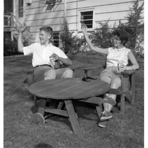 Posterazzi SAL255420829 Young Man & Young Woman Sitting at Outdoor Table & Waving Poster Print - 18 x 24 in.