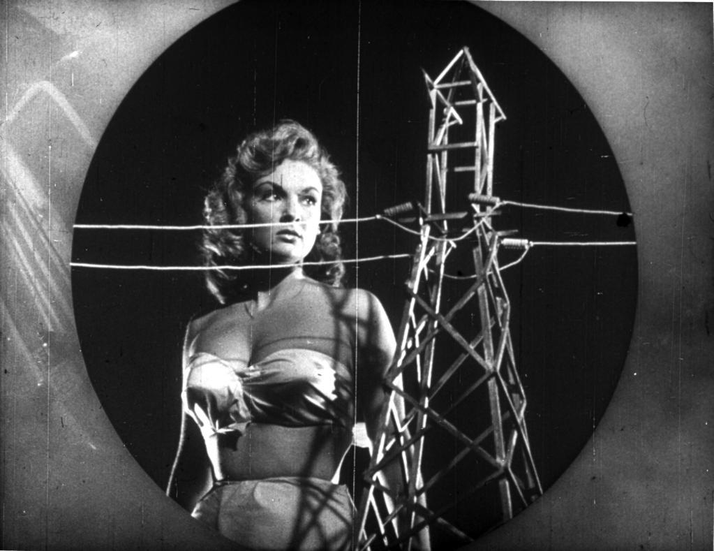 A publicity still of Alison Hayes next to a power pylon Photo Print