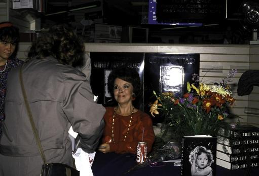 Shirley Temple at a book signing for her autobiography Photo Print