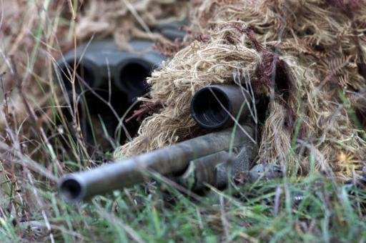 US Marines practice stalking techniques with an M-40 Sniper Rifle Poster Print by Stocktrek Images