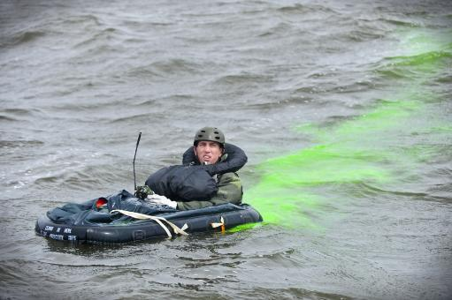 April 18, 2014 - A downed pilot uses radio communication and sea dye to provide his location during a search and rescue training mission in the.