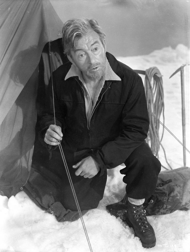 A Publicity Still Of Claude Rains Sitting Next To A Tent Photo Print