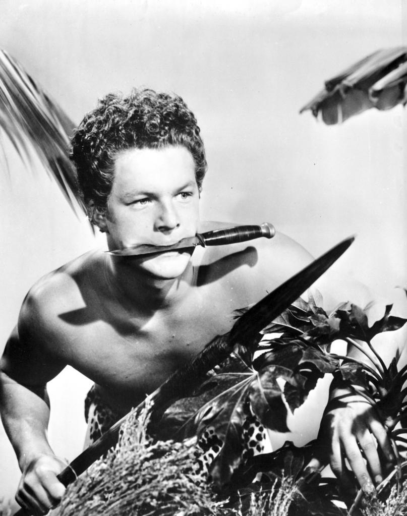 A Promotional Still Of Johnny Sheffield Carrying A Spear Photo Print