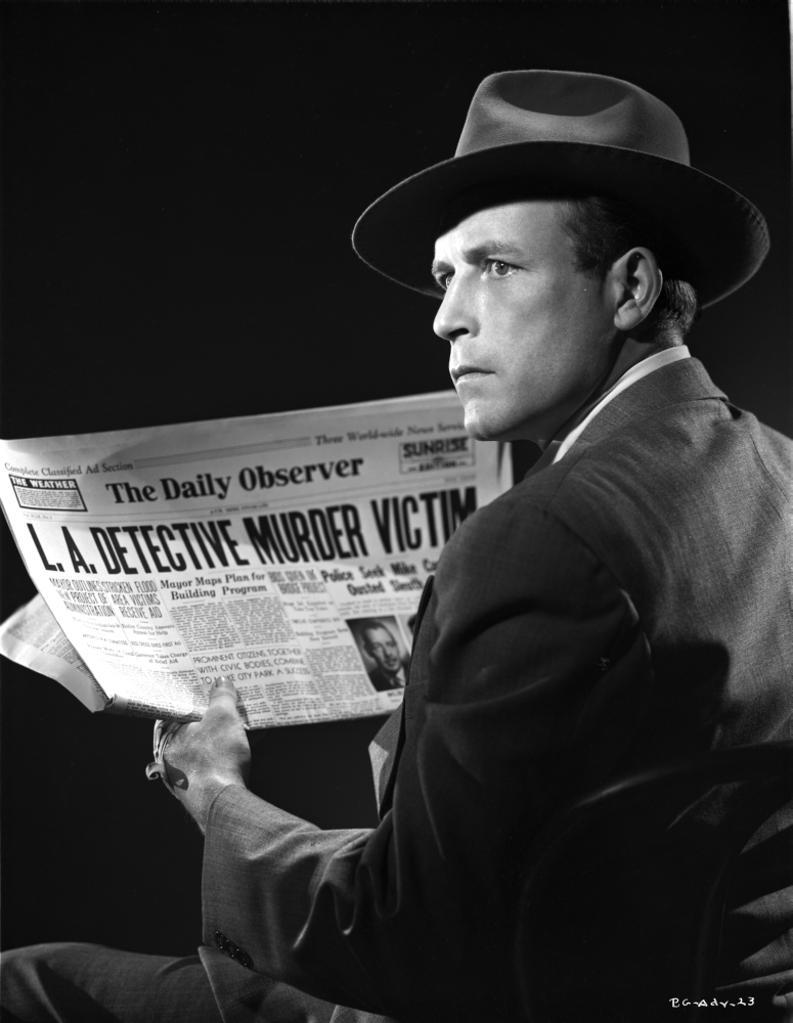 A Publicity Still Of Lawrence Tierney Reading A Newspaper Photo Print