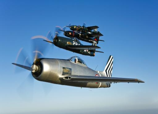 Two Grumman F8F Bearcats and two F7F Tigercats fly in formation near Chino, California Poster Print
