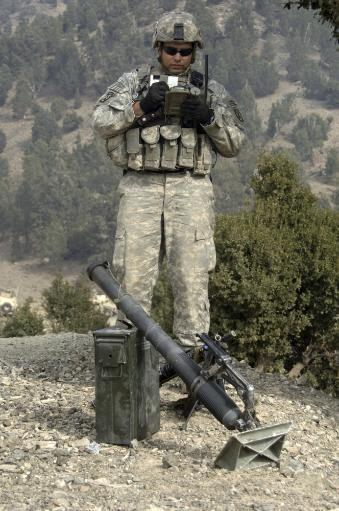 November 10, 2006 - A U.S. Army soldier gets information off of a lightweight handheld mortar ballistic computer, a device used to generate data.
