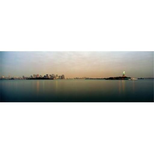 Panoramic Images PPI117701L River with the city skyline and Statue of Liberty in the background New York Harbor New York City New York State USA P