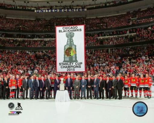 The Chicago Blackhawks raise their 2015 Stanley Cup championship banner at the United Center October 7,2015 Photo Print 722107