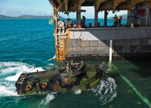 An amphibious assault vehicle enters the well deck of USS Tortuga Poster Print by Stocktrek Images