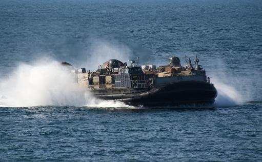 Arabian Gulf, February 7, 2012 - A landing craft air cushion approaches the well deck of the amphibious transport dock ship USS New Orleans.