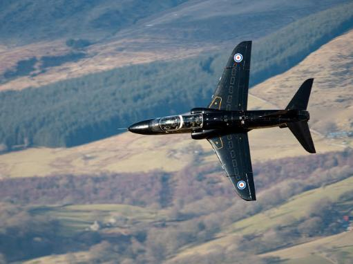 A Hawk T1 trainer aircraft of the Royal Air Force low flying over North Wales Poster Print by Andrew Chittock/Stocktrek Images