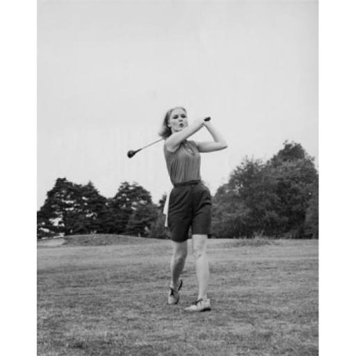 Posterazzi SAL2554720 Young Woman Swinging Golf Club on Golf Course Poster Print - 18 x 24 in.