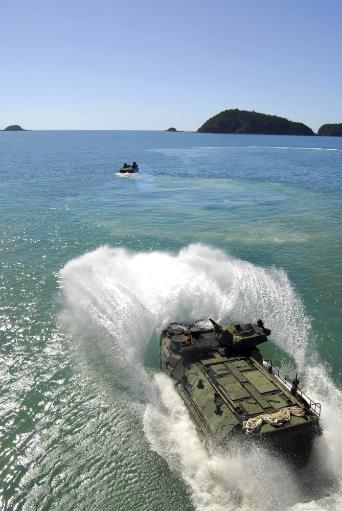 Amphibious Assault vehicles exit the well deck of amphibious transport dock ship USS Denver Poster Print
