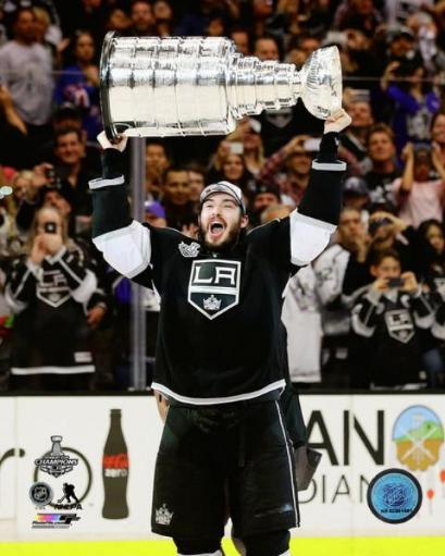 Drew Doughty with the Stanley Cup Game 5 of the 2014 NHL Stanley Cup Finals Photo Print 876368