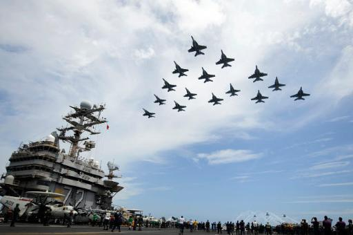Helicopters fire flares as jets fly in formation above the flight deck of USS Abraham Lincoln Poster Print by Stocktrek Images