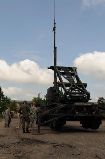 US Soldiers teach the Polish military how to use the Patriot missile system Poster Print by Stocktrek Images