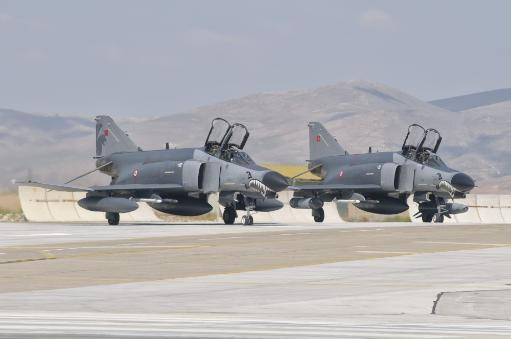 A pair of Turkish Air Force F-4 Phantom aircraft during Exercise Anatolian Eagle at Konya Air Base, Turkey Poster Print