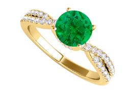 Emerald and CZ Criss Cross Design Ring in Yellow Gold