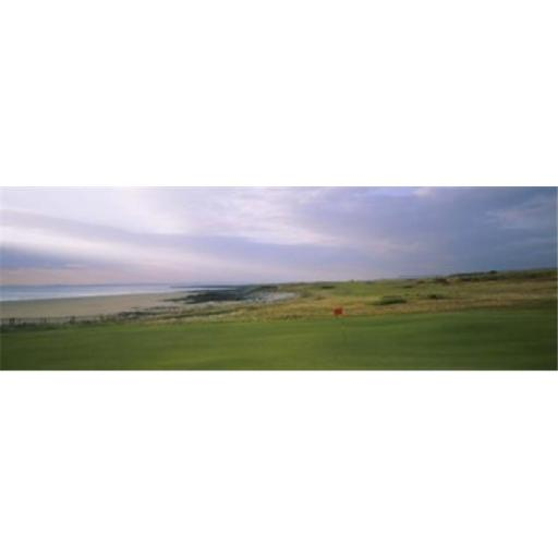Golf flag on a golf course Royal Porthcawl Golf Club Porthcawl Wales Poster Print by - 36 x 12