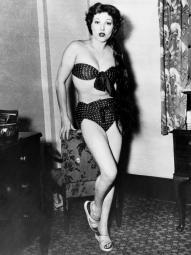 Jean Parker Showing The Bikini That Got Her Ordered Off Bondi Beach In Sydney For Being 'Much Too Scanty' 1951 Photo Print EVCPBDJEPAEC032HLARGE