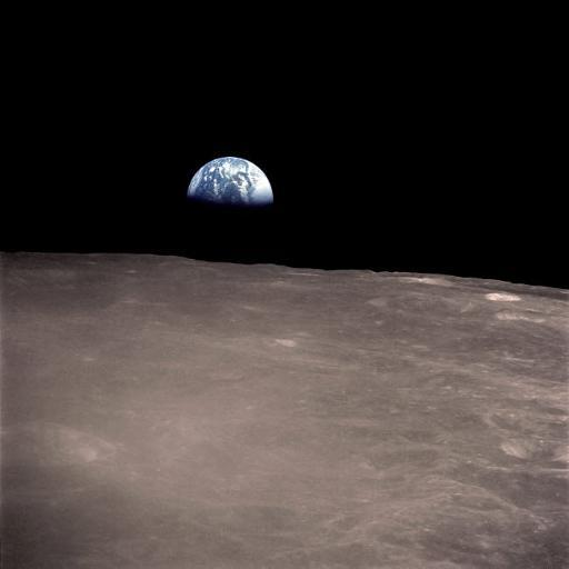 Earth rising above the Moon's horizon Poster Print by Stocktrek Images