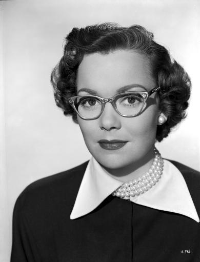 Jane Wyman Portrait in White Collar Black Long Sleeve Shirt and Pearl Necklace with Eyeglasses and Pearl Earrings Photo Print