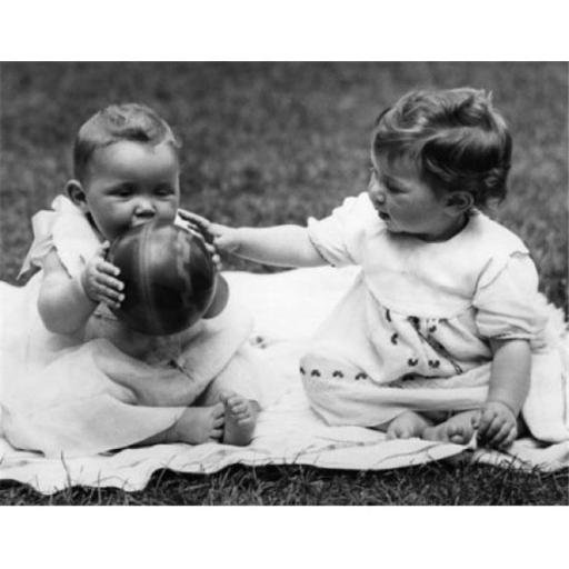 Posterazzi SAL990359109 Two Baby Girls Sitting on Blanket & Playing with Ball Poster Print - 18 x 24 in.