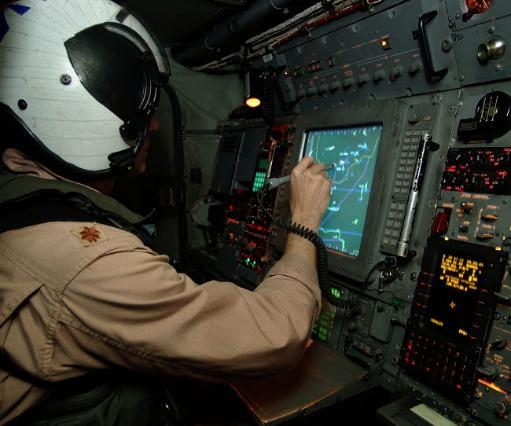 A Naval Flight Officer tracks aircraft at his station on an E-2C Hawkeye Poster Print by Stocktrek Images