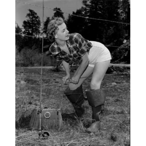 Posterazzi SAL255417931 Young Woman with Fishing Rod & Basket Crossing Barbed Wire Fence Poster Print - 18 x 24 in.