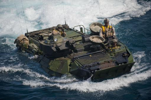 Pacific Ocean, August 19, 2011 - Marines prepare to navigate an amphibious assault vehicle into the well deck of the San Antonio-class amphibious.