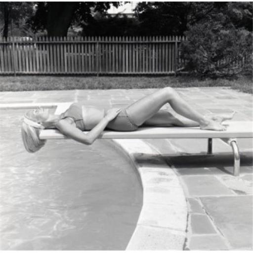 Posterazzi SAL255421073 Young Woman Sunbathing on Trampoline Poster Print - 18 x 24 in. EW1YNRL7K6AFDMCW