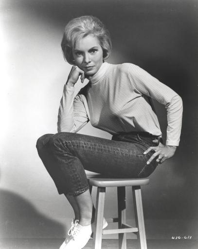 Janet Leigh sitting on a Chiar in White High Neck Long Sleeve Linen Dress with Knees Bent and Head Leaning on the Right Hand Photo Print