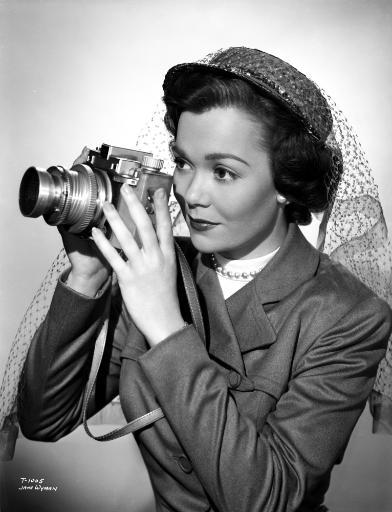 Jane Wyman Portrait in Grey Linen Long Sleeve Suit and White Round-Neck Shirt with Lace Flat Hat and Hands Holding a Camera Photo Print