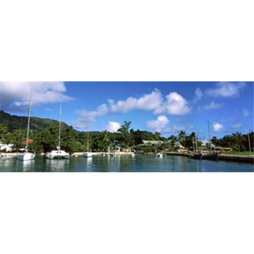Panoramic Images PPI141943L Yachts and small fishing boats at the harbor on La Digue Island Seychelles Poster Print by Panoramic Images - 36 x 12